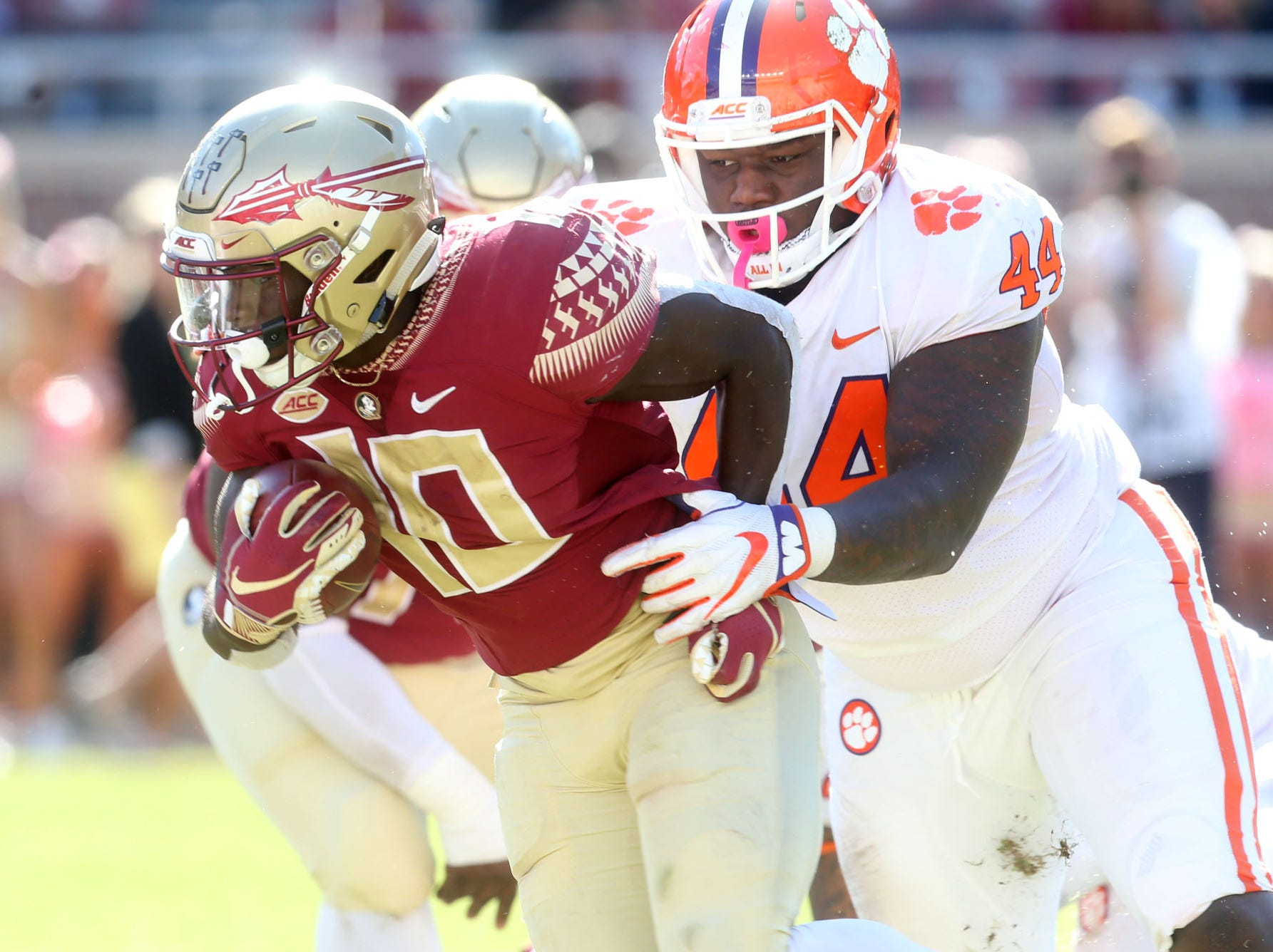 Florida State Seminoles running back Anthony Grant (10) fights off a tackle from Clemson Tigers defensive tackle Nyles Pinckney (44) as the Florida State Seminoles take on the Clemson Tigers in college football at Doak S. Campbell Stadium on Saturday, Oct. 27, 2018.