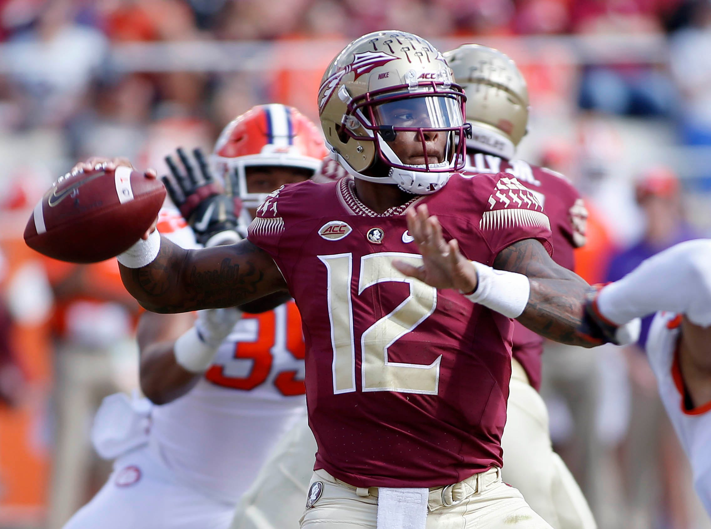 Oct 27, 2018; Tallahassee, FL, USA; Florida State Seminoles quarterback Deondre Francois (12) throws against the Clemson Tigers at Doak Campbell Stadium during the second quarter of play.