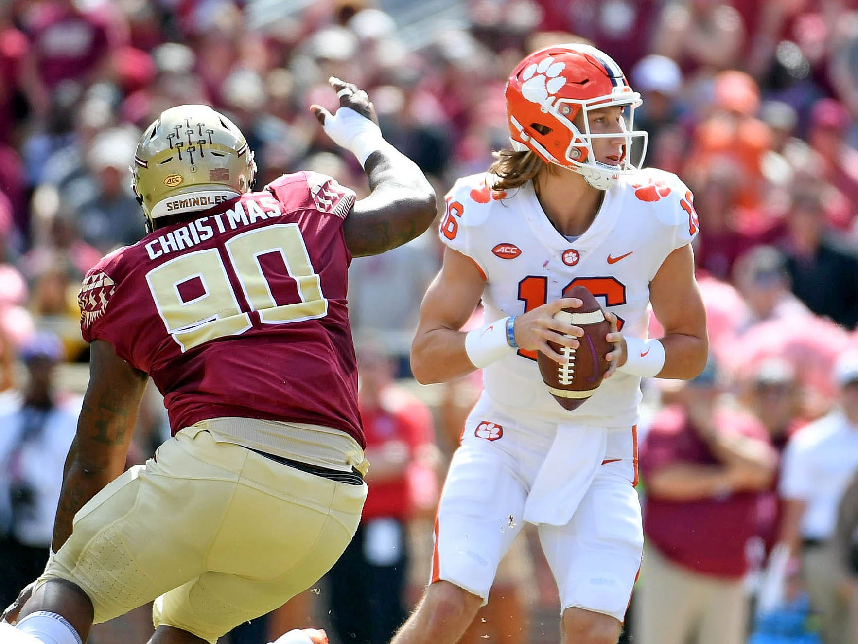 Oct 27, 2018; Tallahassee, FL, USA; Clemson Tigers quarterback Trevor Lawrence (16) looks to throw as he is pressured by Florida State Seminoles defensive tackle Demarcus Christmas (90) during the first half at Doak Campbell Stadium.