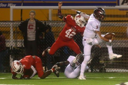 Chiles quarterback Garrett Greene (3) runs for a touchdown against Leon during their game on Friday night at Gene Cox Stadium.
