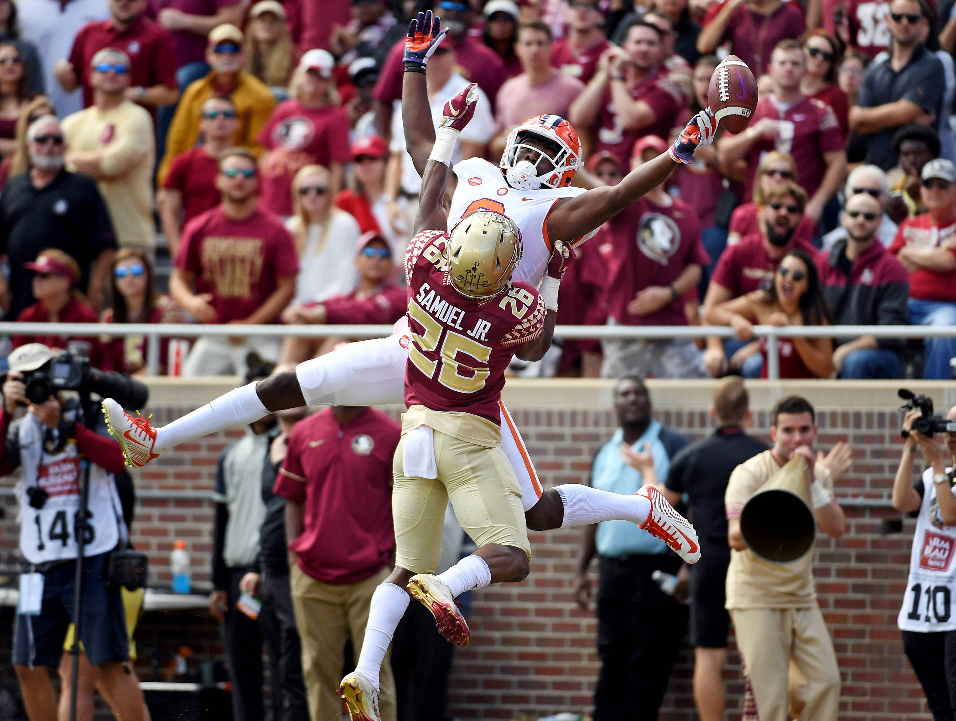 Oct 27, 2018; Tallahassee, FL, USA; Clemson Tigers wide receiver Justyn Ross (8) misses a pass for a touchdown as Florida State Seminoles defensive back Asante Samuel Jr. (26) defends during the first half at Doak Campbell Stadium. Mandatory Credit: Melina Myers-USA TODAY Sports