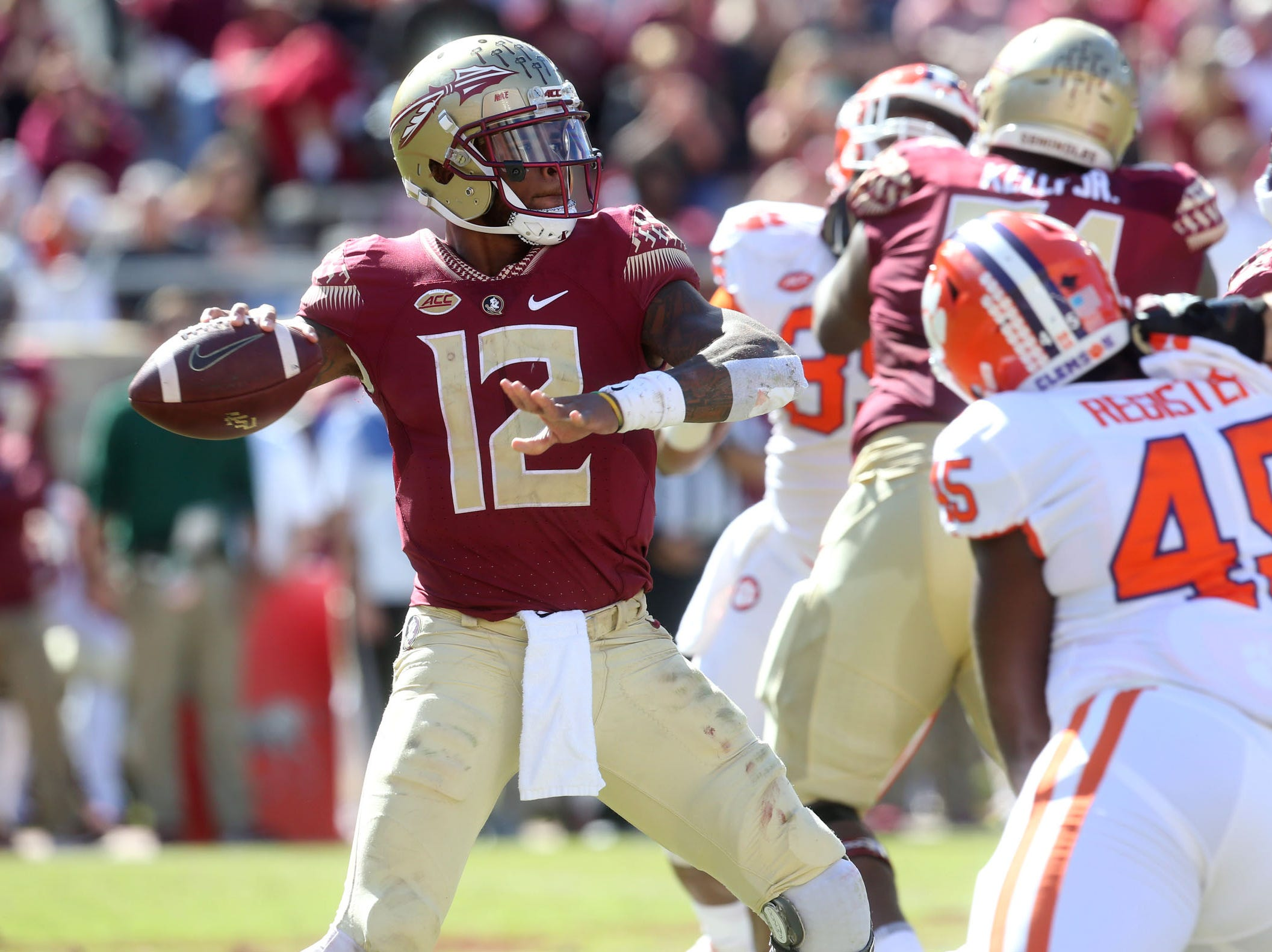 Florida State Seminoles quarterback Deondre Francois (12) looks to pass as the Florida State Seminoles take on the Clemson Tigers in college football at Doak S. Campbell Stadium on Saturday, Oct. 27, 2018.