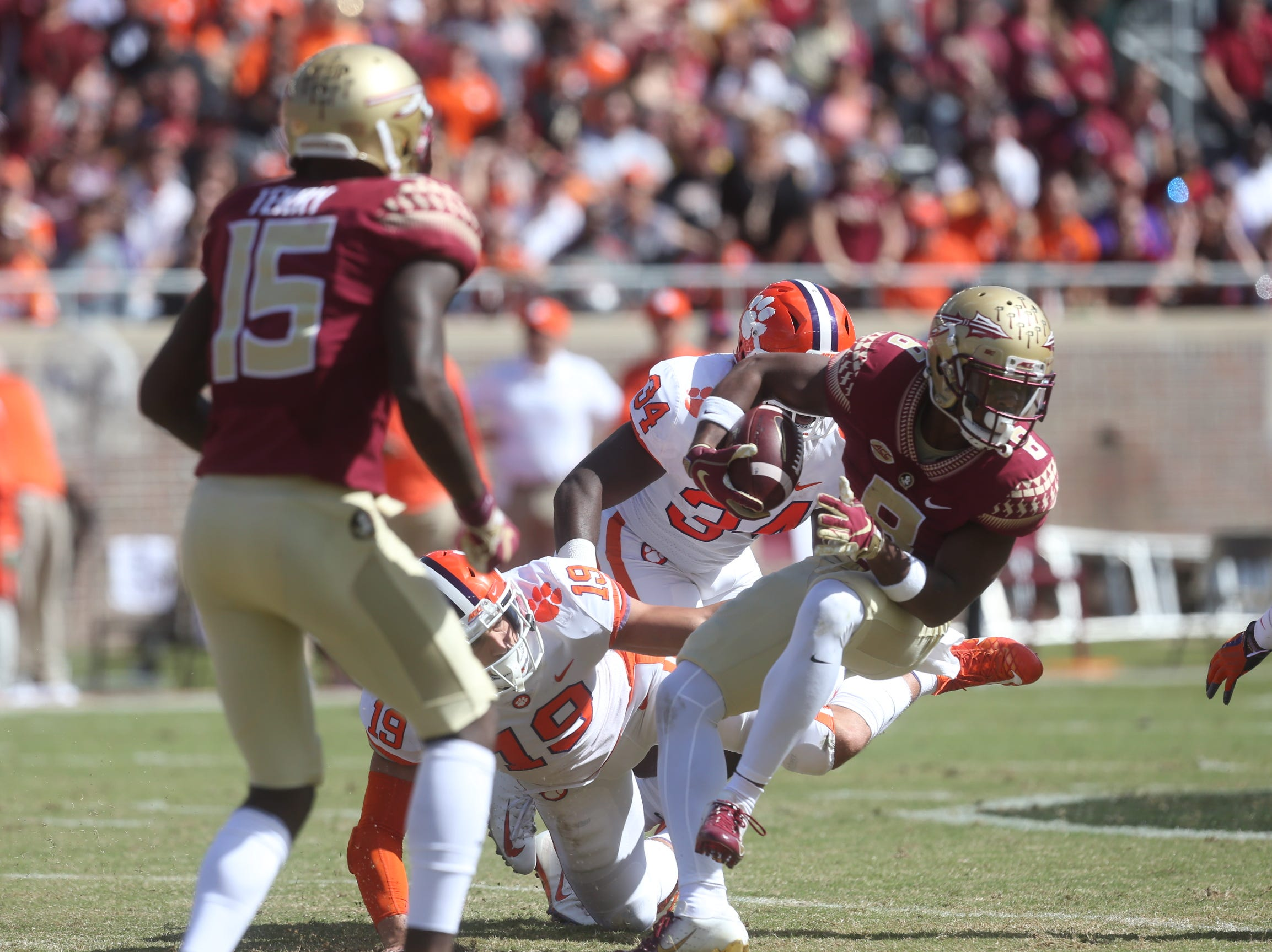 Florida State Seminoles running back Jacques Patrick (9) fights off a tackle from Clemson Tigers safety Tanner Muse (19) as the Florida State Seminoles take on the Clemson Tigers in college football at Doak Stadium on Saturday, Oct. 27, 2018.
