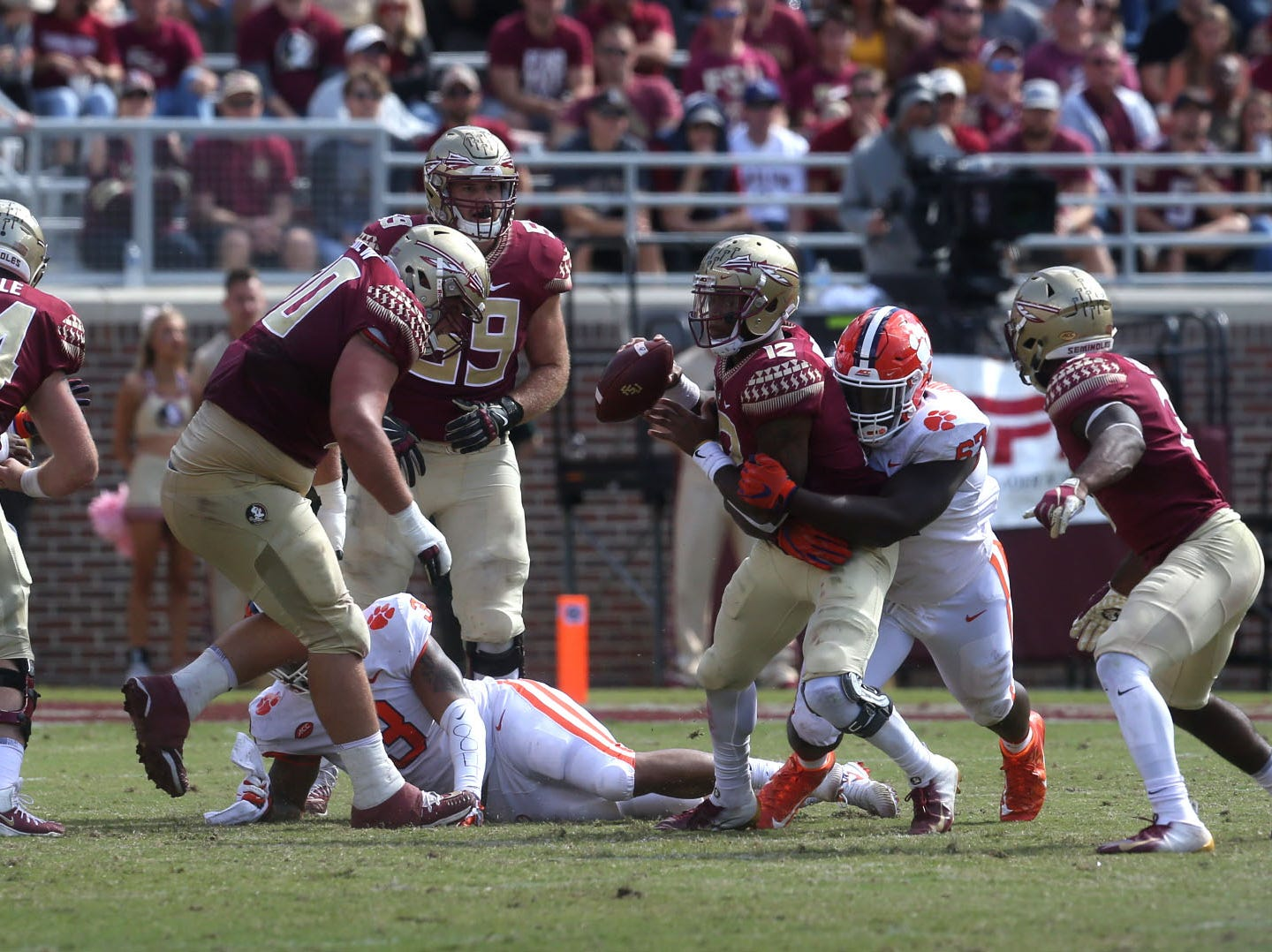 Florida State Seminoles quarterback Deondre Francois (12) gets sacked by Clemson Tigers defensive tackle Albert Huggins (67) as the Florida State Seminoles take on the Clemson Tigers in college football at Doak S. Campbell Stadium on Saturday, Oct. 27, 2018.