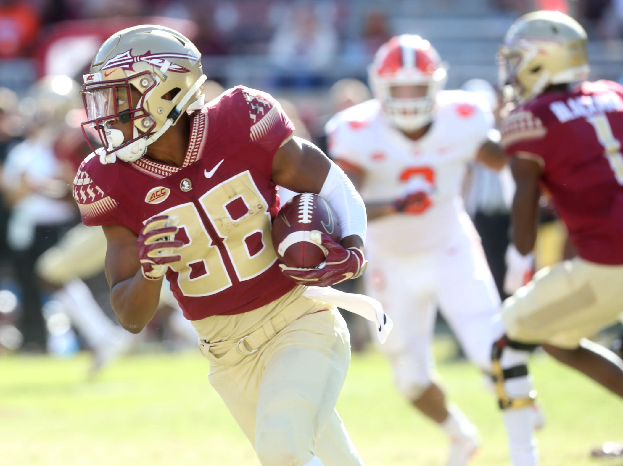 Florida State Seminoles wide receiver Tre'Shaun Harrison (88) makes a run to gain some yards as the Florida State Seminoles take on the Clemson Tigers in college football at Doak S. Campbell Stadium on Saturday, Oct. 27, 2018.