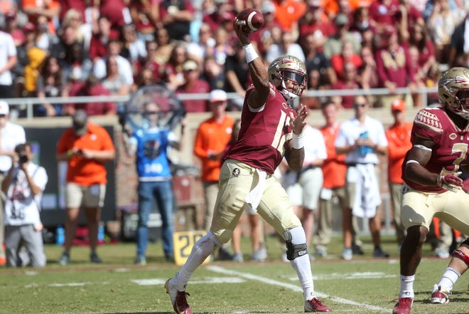 Florida State Seminoles quarterback Deondre Francois (12) passes to an open player as the Florida State Seminoles take on the Clemson Tigers in college football at Doak S. Campbell Stadium on Saturday, Oct. 27, 2018.