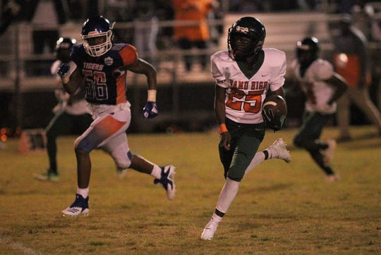 FAMU DRS' Jason Jackson runs with the ball after a catch against Jefferson County.