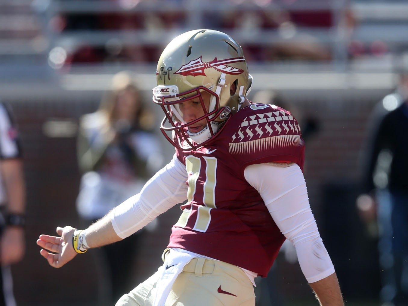 Florida State Seminoles punter Logan Tyler (21) as he punts the ball as the Florida State Seminoles take on the Clemson Tigers in college football at Doak S. Campbell Stadium on Saturday, Oct. 27, 2018.