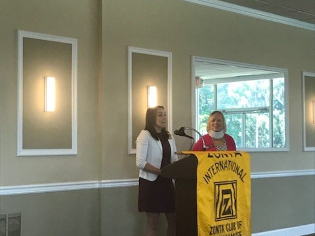 Ms. Barbee being presented with her award at the monthly meeting by scholarship Chair Peggy Allen.