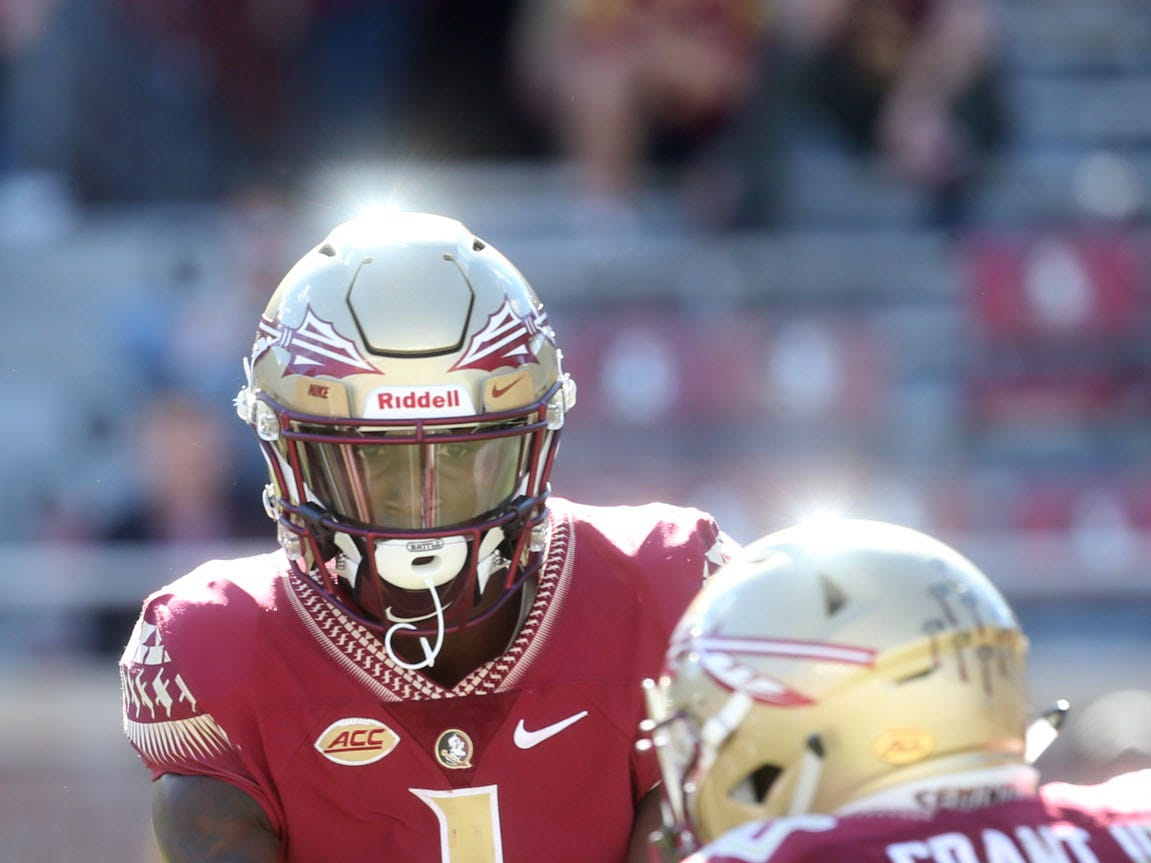 Florida State Seminoles quarterback James Blackman (1) hands off the ball to Florida State Seminoles running back Anthony Grant (10) as the Florida State Seminoles take on the Clemson Tigers in college football at Doak S. Campbell Stadium on Saturday, Oct. 27, 2018.