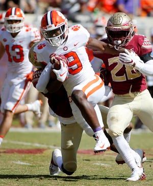 Oct 27, 2018; Tallahassee, FL, USA; Clemson Tigers running back Travis Etienne (9) picks up a first down against the Florida State Seminoles at Doak Campbell Stadium during the second quarter of play.