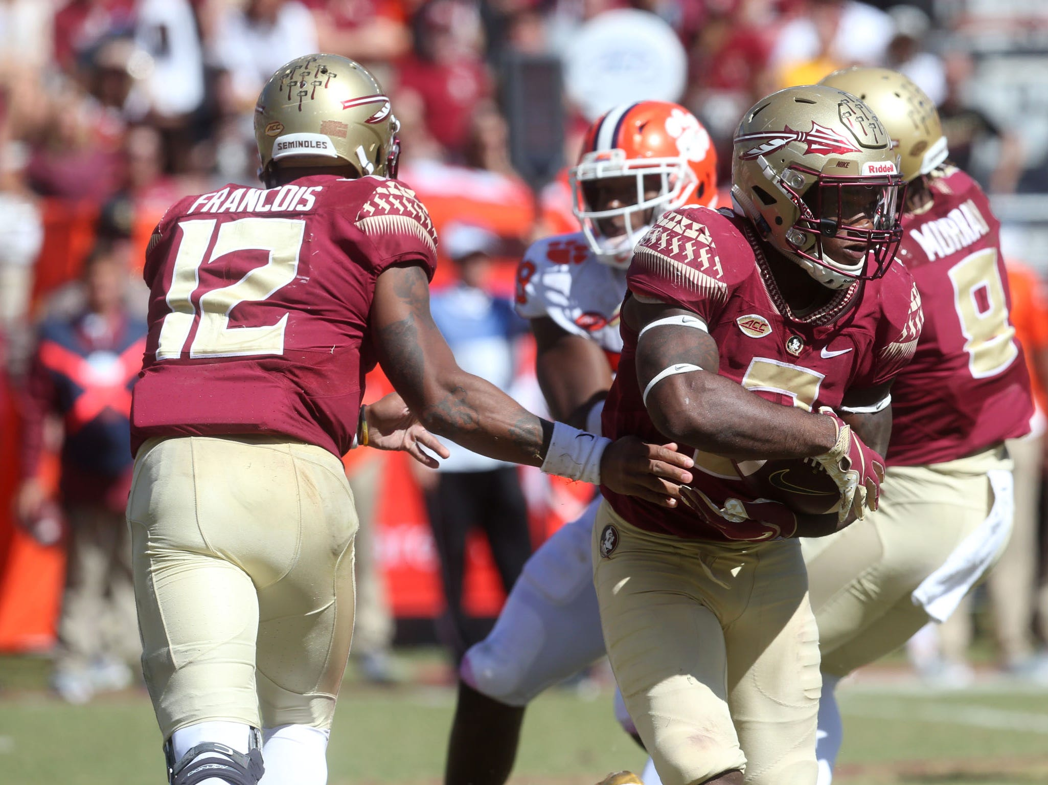 Florida State Seminoles running back Cam Akers (3) takes the hand off from Florida State Seminoles quarterback Deondre Francois (12) as the Florida State Seminoles take on the Clemson Tigers in college football at Doak S. Campbell Stadium on Saturday, Oct. 27, 2018.