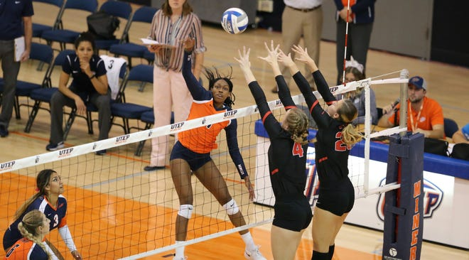 UTEP freshman Serena Patterson goes for the kill against the Western Kentucky block Friday night in Memorial Gym.