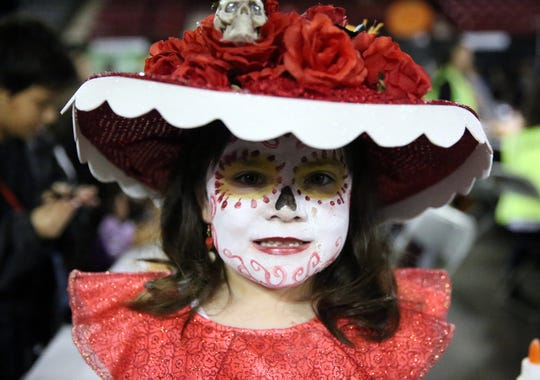"""Marguerite Estrada, 5, is dressed as Catrina from """"The Book of Life."""""""