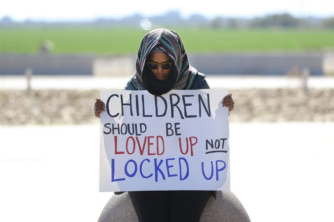 Yadenee Hailu from Tulsa, Okla., attends a protest outside the Tornillo tent city Saturday. Two separate protests at the Tornillo detention site for immigrants joined forces Saturday to demand an end to family separations and detentions. One was organized by Hope Border Institute and the other by a group of immigration and civil rights attorneys.
