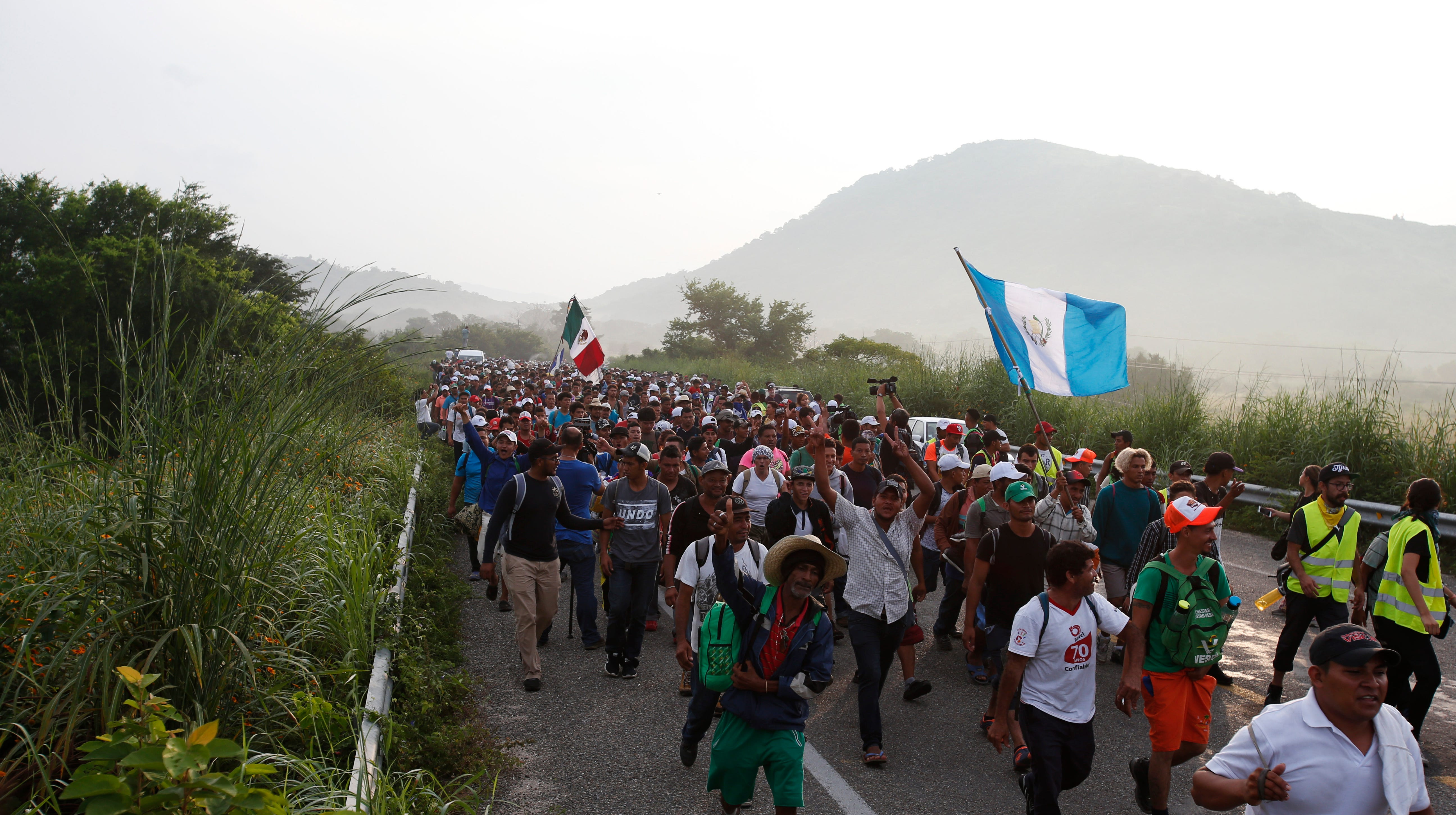 Migrants walk along the road after Mexico's federal police briefly blocked the highway in an attempt to stop a thousands-strong caravan of Central American migrants from advancing, outside the town of Arriaga, Chiapas State, Mexico, on Saturday, Oct. 27, 2018. Hundreds of Mexican federal officers carrying plastic shields had blocked the caravan from advancing toward the United States, after thousands of the migrants turned down the chance to apply for refugee status and obtain a Mexican offer of benefits.