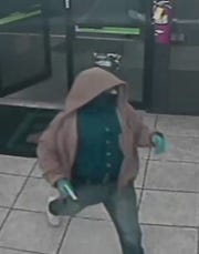 The robber is described as approximately 5 feet 6 inches tall, with a medium to husky build. He was wearing a partial mask that covered his face, a brown coat, a blue button-up shirt, blue denim jeans and white athletic shoes.