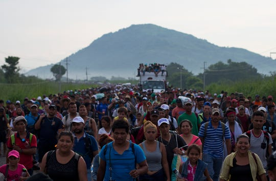 Thousands of Central American migrants fill the highway as they walk outside Arriaga, Mexico, on Saturday, Oct. 27, 2018. Many migrants said they felt safer traveling and sleeping with several thousand strangers in unknown towns than hiring a smuggler or trying to make the trip alone.