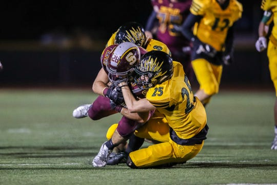 Royal's Jony Ireland tackles Simi Valley's Jackson Sterling during Friday night's game.