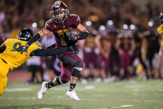 Simi Valley's Malik Hunt attempts to elude Royal's Colin Mitchell duing Friday night's game.