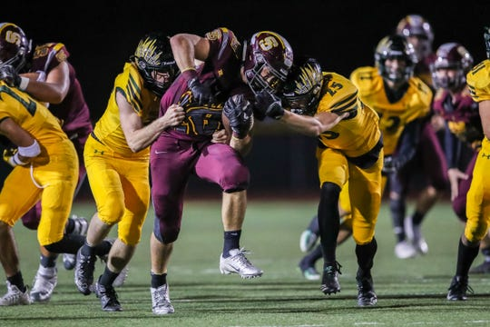 Simi Valley's Jackson Sterling tries to break free of the Royal defense on Friday night.