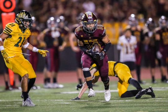 Simi Valley's Malik Hunt runs the ball up field during Friday night's game against Royal.