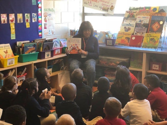 """Linda Gallina, a member of the Woman's Club of Vineland, reads """"Maybe Something Beautiful"""" to Sharon Sileo's first-grade class at D'Ippolito Elementary School in Vineland as part of """"Read for the Record Day."""""""