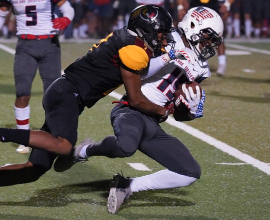Tulare Union's Xavier Hailey makes a tackle against Tulare Western in the annual Bell game on Friday, October 26, 2018 at Bob Mathias Stadium.