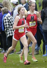 Medford's Alicia Kawa, left, and Franny Seidel run side-by-side in the Division 2 girls race during the WIAA state cross country meet Saturday at Ridges Golf Course. The Raiders edged defending champion Freedom for the team title.