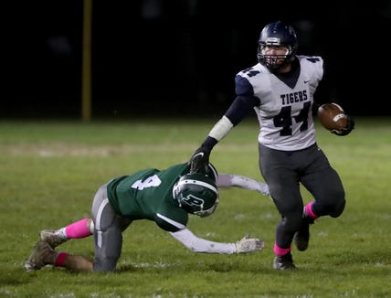 John Listwan of Putnam Valley gets by Brendan O'Neill of Pleasantville during a Class B semifinal football game at Parkway Field in Pleasantville Oct 26, 2018. Putnam Valley defeated Pleasantville 36-25.