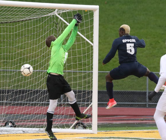 Briarcliff's Jason Oppong scores one of his three goals past Blind Brook goalie Michael Abrutyn in the Class B Section 1 boys soccer championship at Lakeland Oct. 27, 2018. Briarcliff won 3-2.