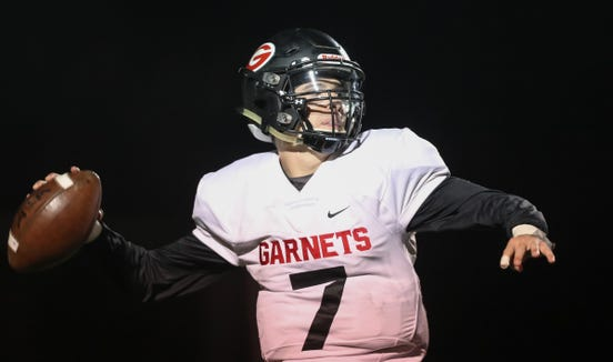 Rye quarterback Declan Lavelle (7) throws a pass during their 28-21 win over Clarkstown South in the Class 'A' semifinal football game at Clarkstown South High School in West Nyack on Friday, October 26, 2018.