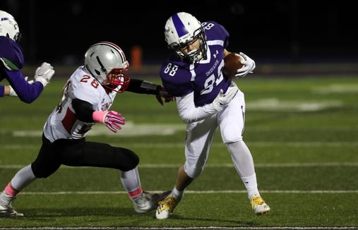 John Jay's Tommy Feinstein (88) breaks away from Somers' Brian Marcus (28) after a first half catch during semifinal playoff football action at John Jay High School in Cross River Oct. 26, 2018.