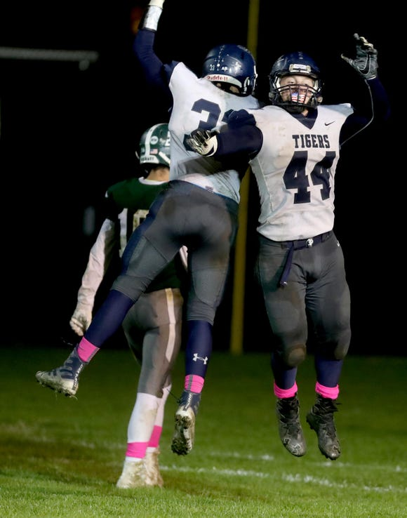 John Listwan of Putnam Valley celebrates with a teammate after scoring against Pleasantville during a Class B semifinal football game at Parkway Field in Pleasantville Oct 26, 2018. Putnam Valley defeated Pleasantville 36-25.
