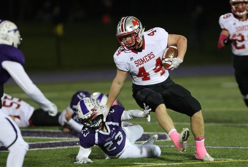 Somers' Jack Kaiser (44) looks for some running room in the John Jay defense during semifinal playoff football action at John Jay High School in Cross River Oct. 26, 2018.