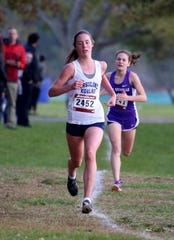 Sarah Flynn of Ursuline approaches the finish line to win the Westchester County Cross Country Championships at Croton Point Park Oct. 26. Finishing second was Teresa Deda of New Rochelle.