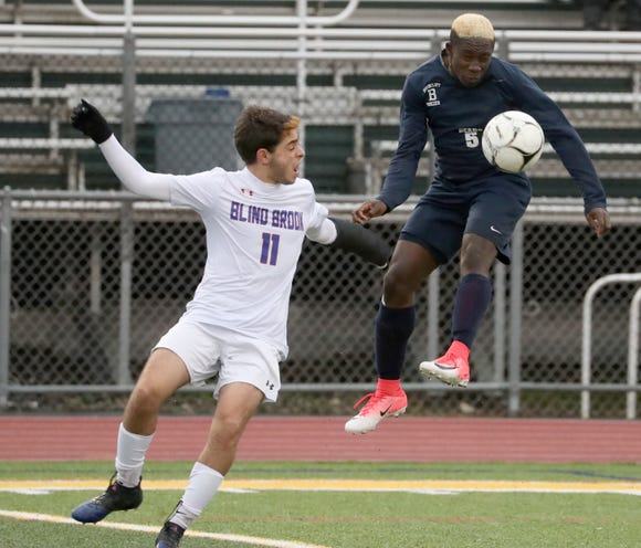 Briarcliff's Jason Oppong, right, is pressured by Blind Brook David Rosenberg in the Class B Section 1 boys soccer championship at Lakeland Oct. 27, 2018. Briarcliff won 3-2.
