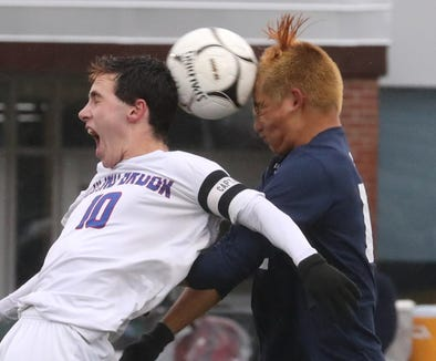 Blind Brook's Zachary Kornblum, left, gets his head on the ball along with Briarcliff's Chris Li during the Class B Section 1 boys soccer championship at Lakeland Oct. 27, 2018. Briarcliff won 3-2.