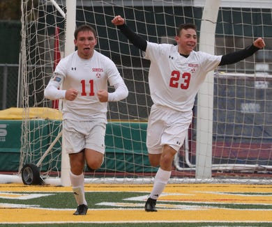 Somers' John Riina (11) celebrates his goal with Bennett Leitner during the Class A Section 1 boys soccer championship at Lakeland Oct. 27, 2018. Somers beat Pearl River 4-2.