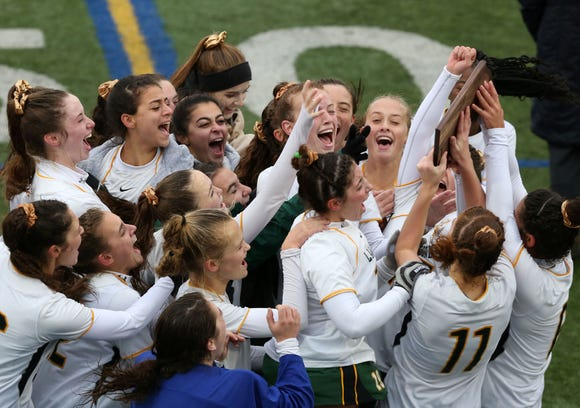 Lakeland players celebrate with the Section 1 plaque after defeating John Jay (CR) 6-1in the girls Class A Section 1 final at Brewster High School Oct. 27, 2018.
