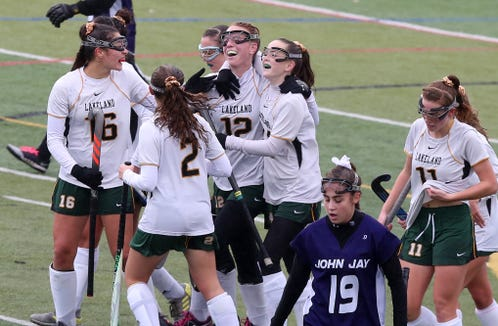 Lakeland players celebrate a first half goal by Emma Halderman (12) against John Jay (CR) during the girls Class A Section 1 final at Brewster High School Oct. 27, 2018. Lakeland won the game 6-1.