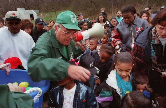Angelo Martinelli, then president of the Yonkers Police Athletic League, hands out Easter Eggs at Redmond Field in Yonkers, April 3, 1999.