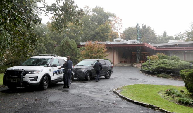 Police provide a presence outside Temple Beth Abraham in Tarrytown, N.Y. Oct. 27, 2018 after a shooting in a Pittsburgh synagogue left eight people dead. Synagogues in Westchester County, just north of New York City, initiated a phone tree to alert the local Jewish community of suspicious activities and any possible copy cat activities after the Pittsburgh shooting.