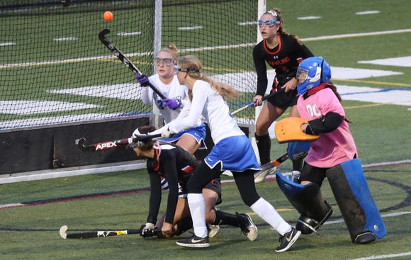 From left, North Salem's Megan Marano (3) deflects a shot from Pawling's Bela Santiago (13) during the Section 1 field hockey championship at Brewster High School Oct. 27, 2018.