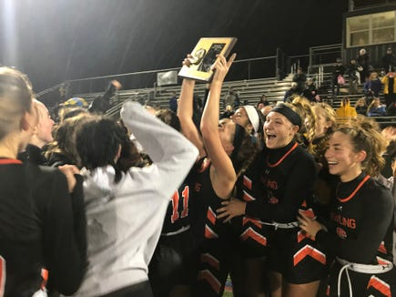 Pawling field hockey players celebrate with the championship plaque after defeating North Salem in the Section 1 Class C title game at Brewster High School on Saturday, October 27th, 2018.
