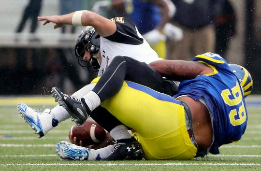 Towson quarterback Tom Flacco avoids a sack by Delaware defensive lineman Cam Kitchen on a late second quarter scoring drive at Delaware Stadium Saturday.