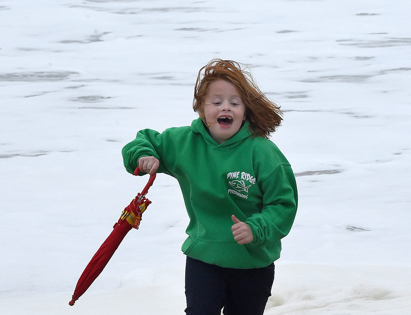 Aubrey Chmielewski 7 from Towson, Md., runs from the water as Rehoboth Beach's Annual Sea Witch Festival is underway despite a Nor'easter passing over the beach area. The ocean is coming up to the Dune Line as sea foam spray's the beach as high winds have blown sand on the boardwalk. There was a Kids Bike Parade on the boardwalk Friday afternoon along with a Kids Train Ride in Grove Park.  Special to the News Journal / CHUCK SNYDER
