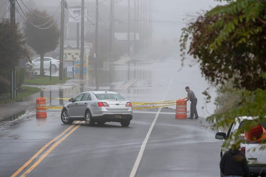 A police officer blocks Savannah Road in Lewes due to standing water in the road during Delaware's first nor'easter of the season in late October 2018.