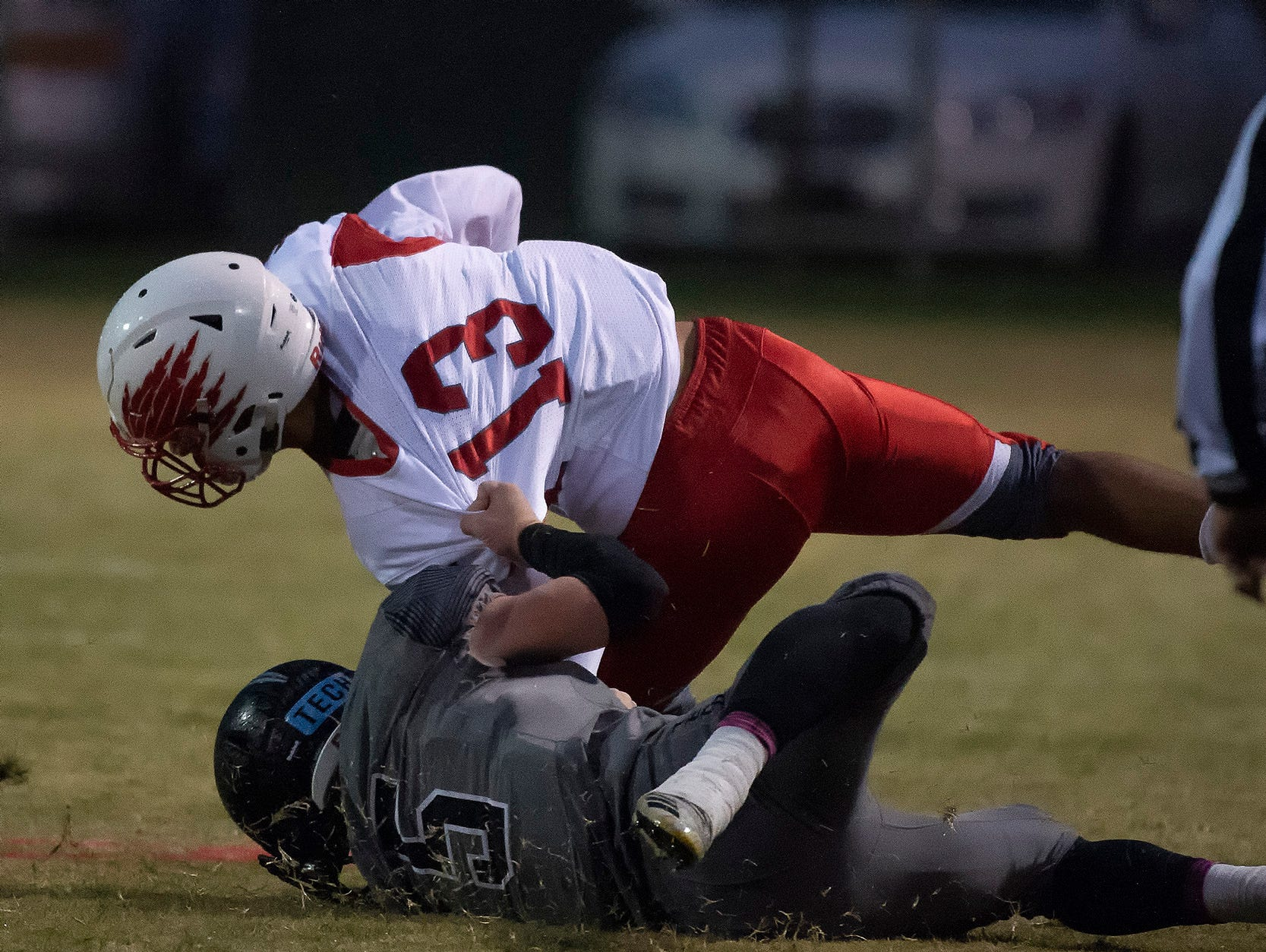 Sussex Tech's Trey Hatfield (5) pulls Smyrna's Makhi Jackson (13) down to the ground in their 61-6 win.