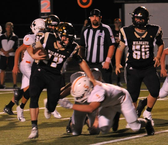 Archer City Wildcats, Quarterback, Ty Bates breaks a tackle and runs the ball in for a touchdown Friday night during the Wildcats game against the Petrolia Pirates.